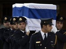 Israel's Sharon laid to rest in military funeral